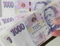 Metropolitní spořitelní družstvo nyní nemůže přijímat ani vyplácet vklady klientů - Na snímku : tisícikorunové bankovky