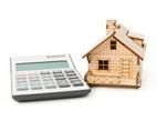 Obrázek: Kalkulačka a dům
